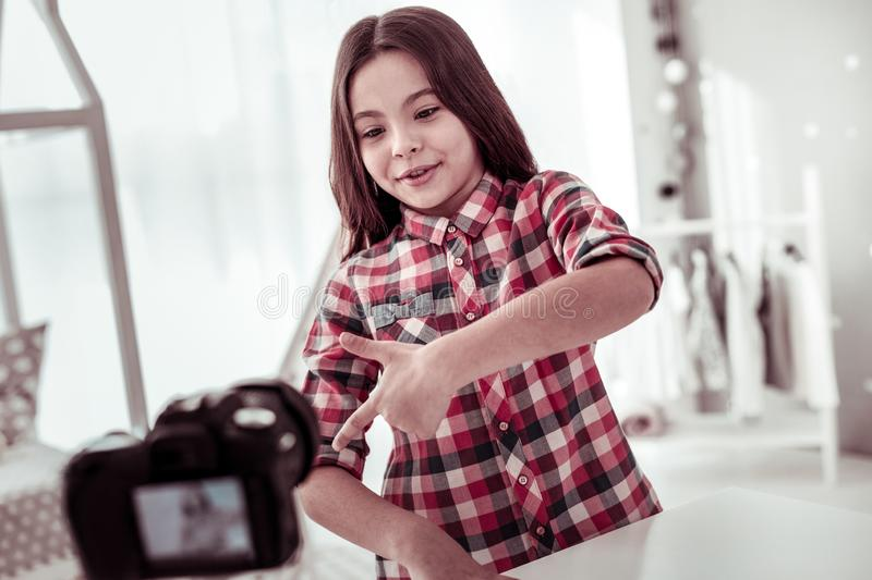 Happy positive girl talking to her viewers royalty free stock images