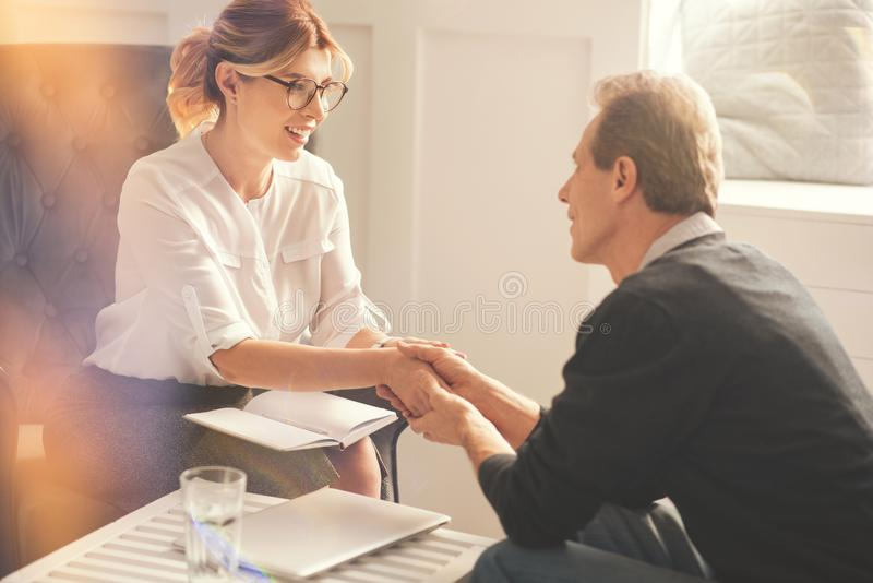 Happy positive man being grateful to his therapist royalty free stock photography