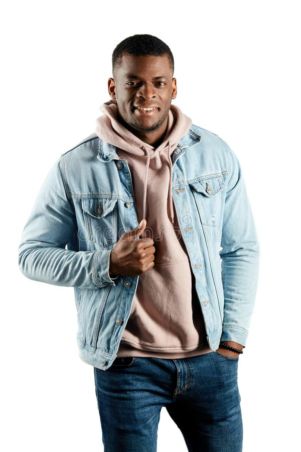 Happy positive man showing his trendy clothes stock photos