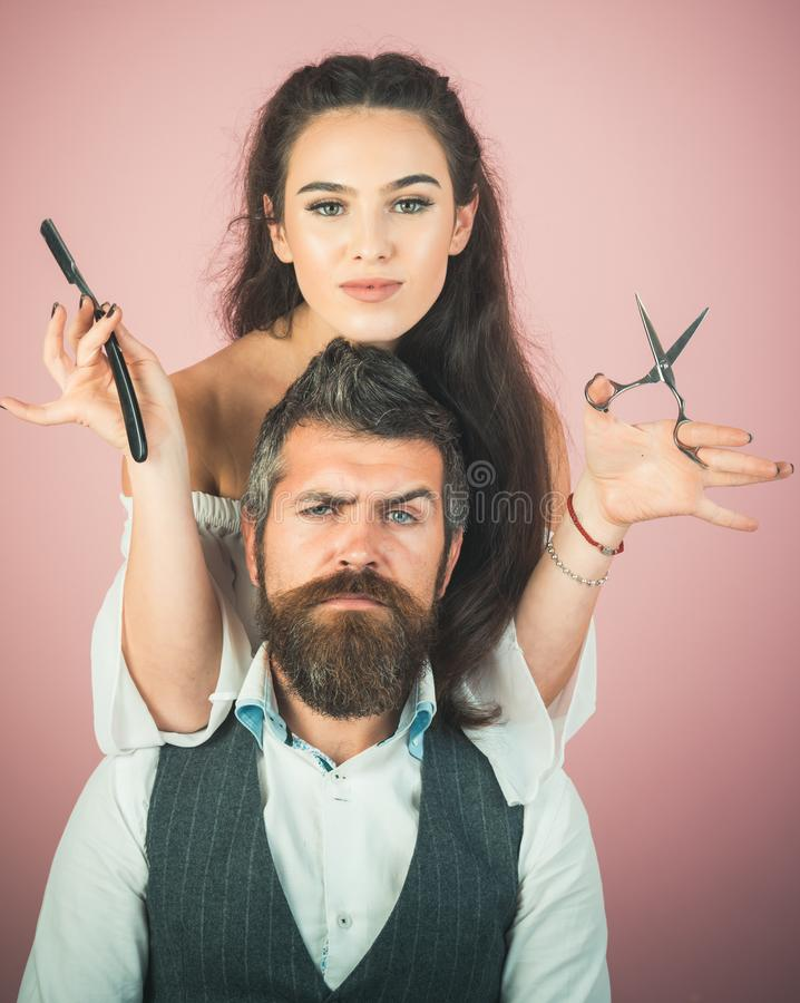 Happy positive woman and bearded man, hairdresser stock photo