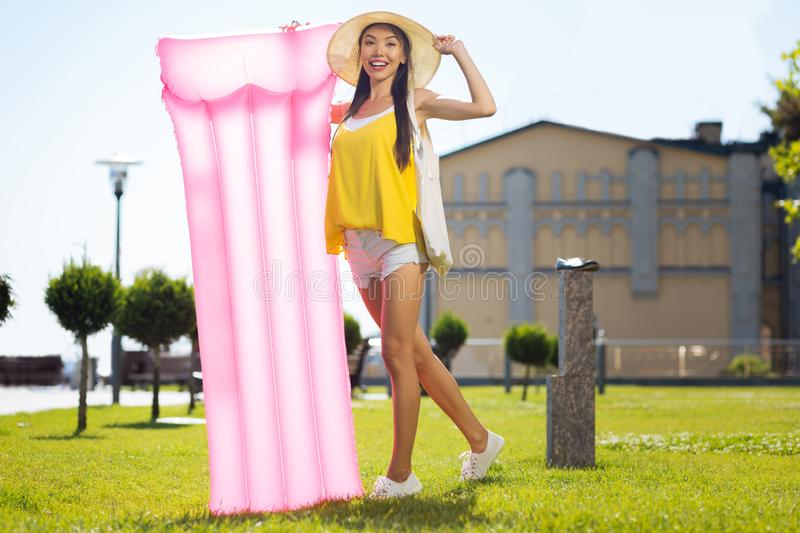 Happy positive woman going to the beach royalty free stock image