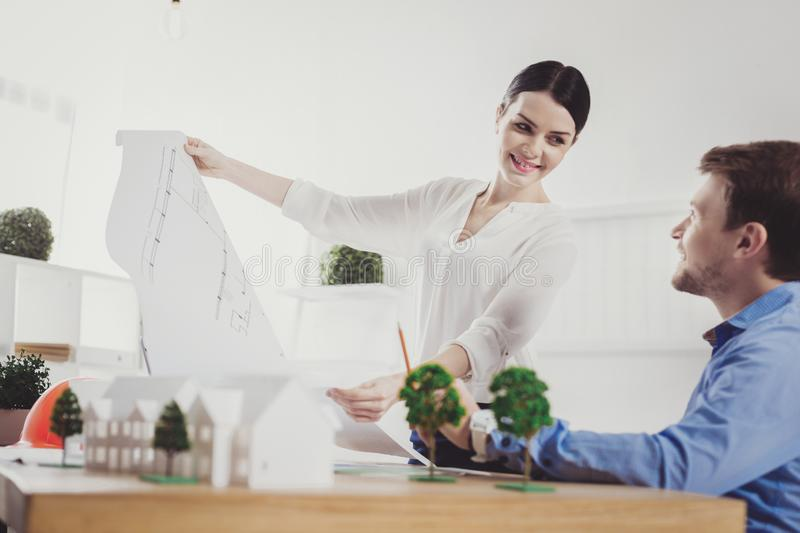 Happy positive woman looking at her colleague royalty free stock photos