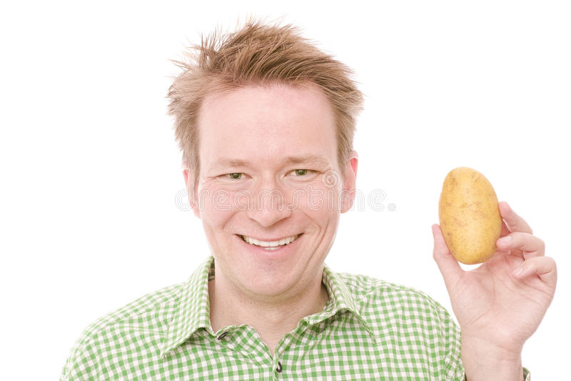 Happy potato. Young happy smiling man holding a potato - isolated on white and retouched royalty free stock photo