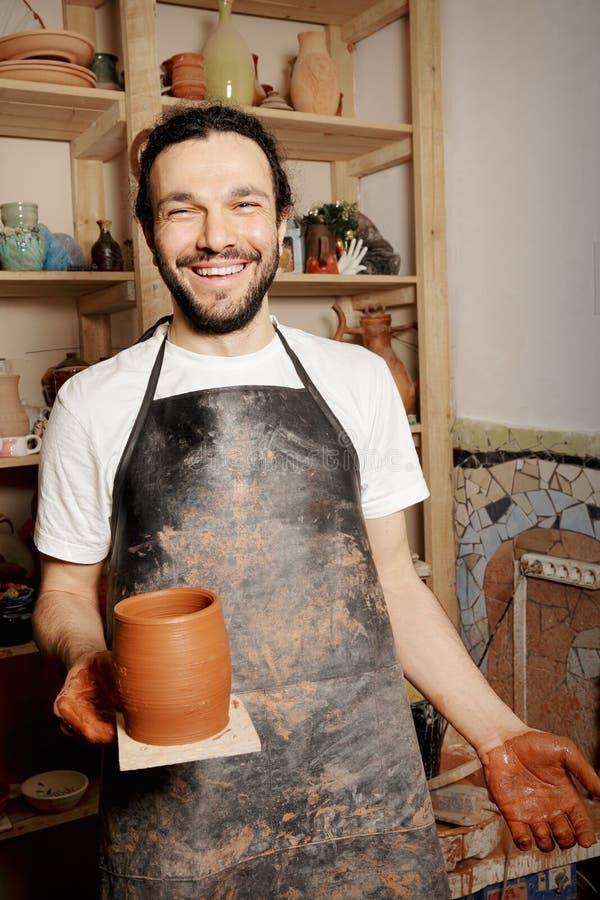 Happy potter stock photo