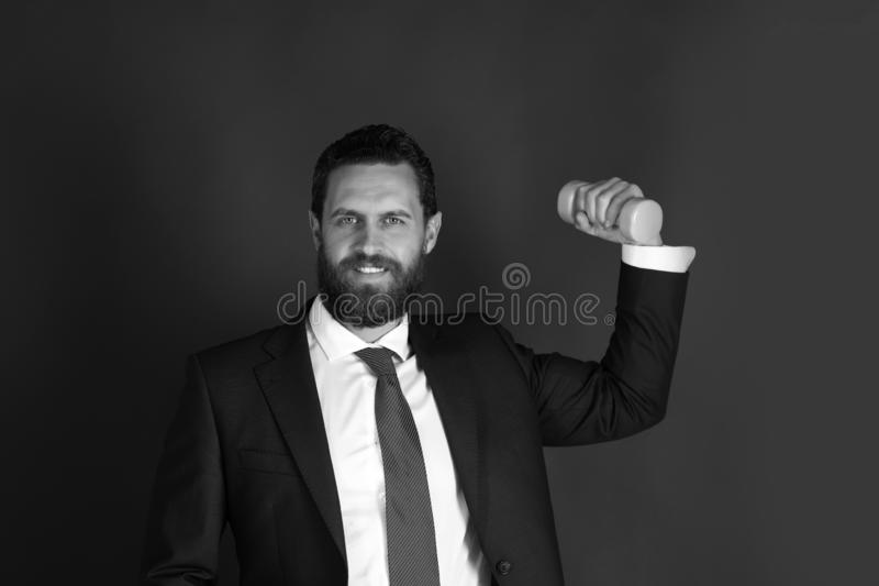 Happy powerful man or smiling businessman with heavy barbell, business. Concept stock images