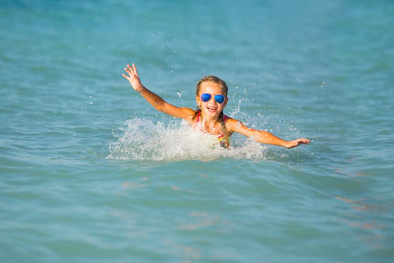 Cute young girl playing in the sea. stock photo