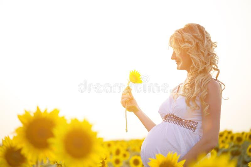 Happy pregnancy. A happy pregnancy woman outdoors