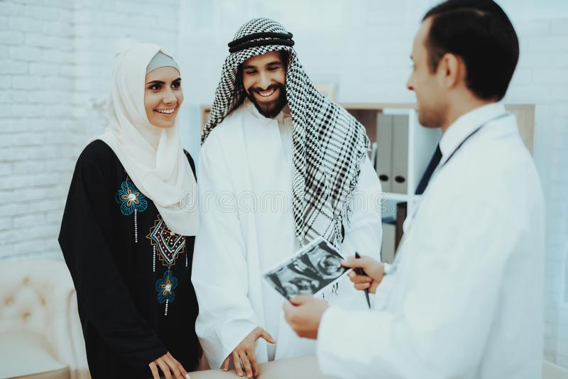 Happy Pregnancy Muslim Woman with Arabic Husband stock photo