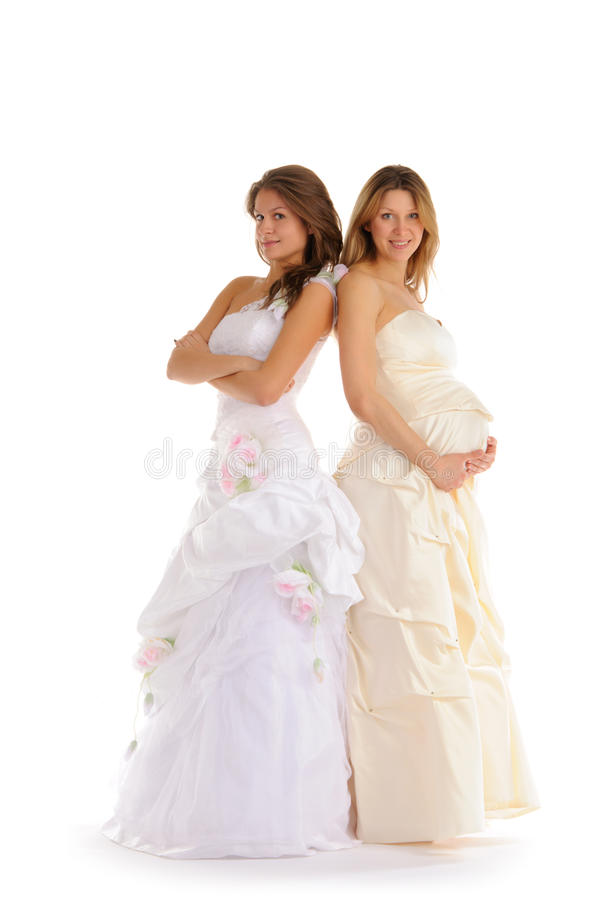 Happy pregnant bride with girlfriend. Isolated on white royalty free stock image