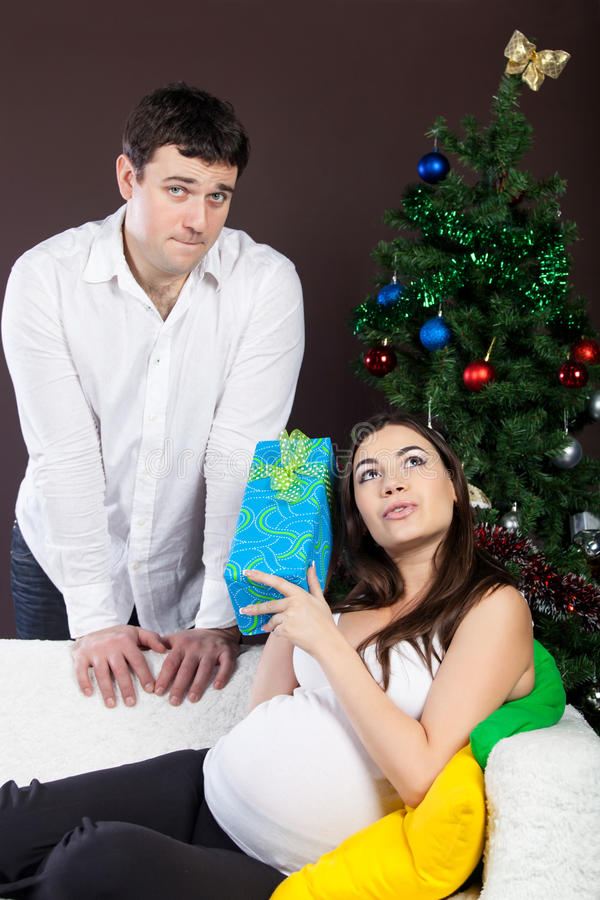 Download Happy Pregnant Couple Near The Christmas Tree Stock Image - Image: 26469413