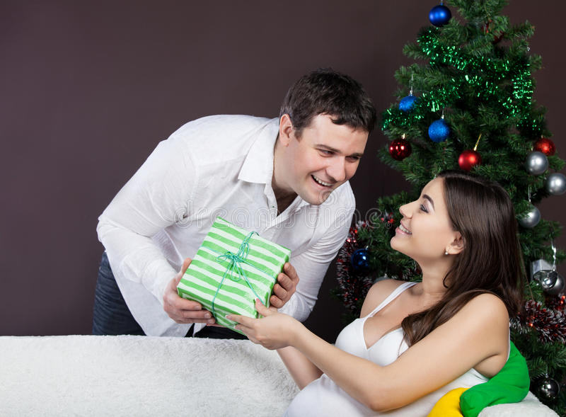Download Happy Pregnant Couple Near The Christmas Tree Stock Photo - Image: 26469416