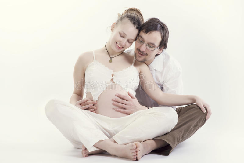 Happy pregnant couple. On white background royalty free stock photography