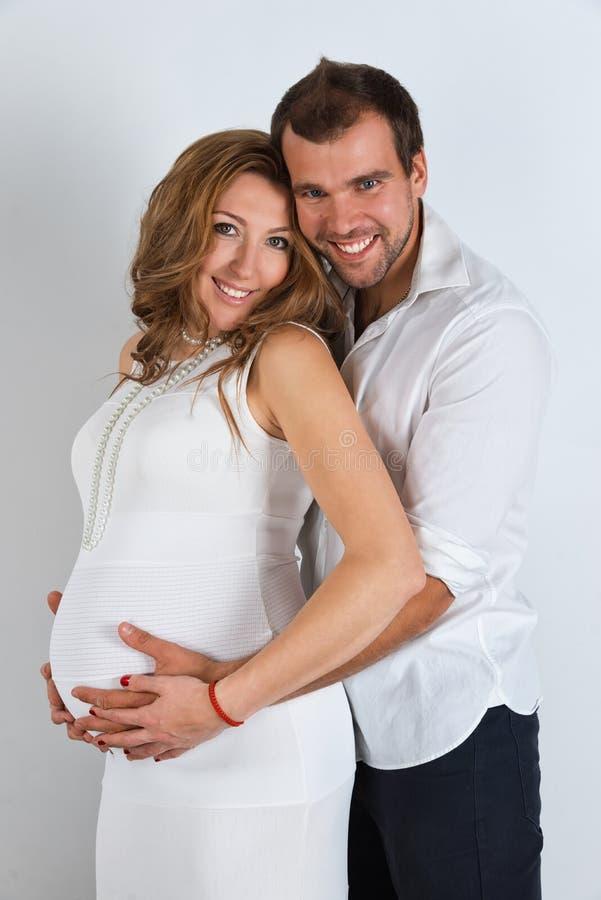 Happy Pregnant Couple on white background stock image