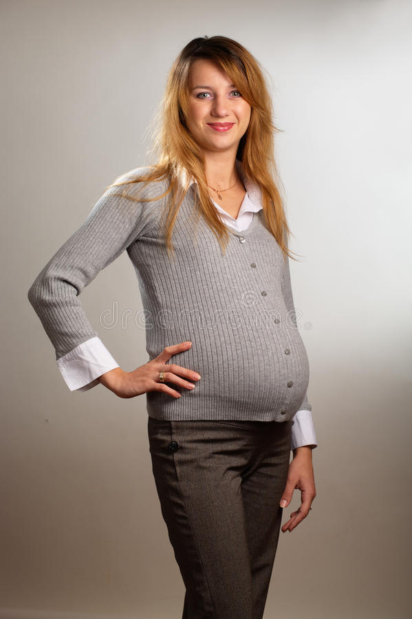 Download Happy pregnant woman stock photo. Image of trousers, happy - 16854654