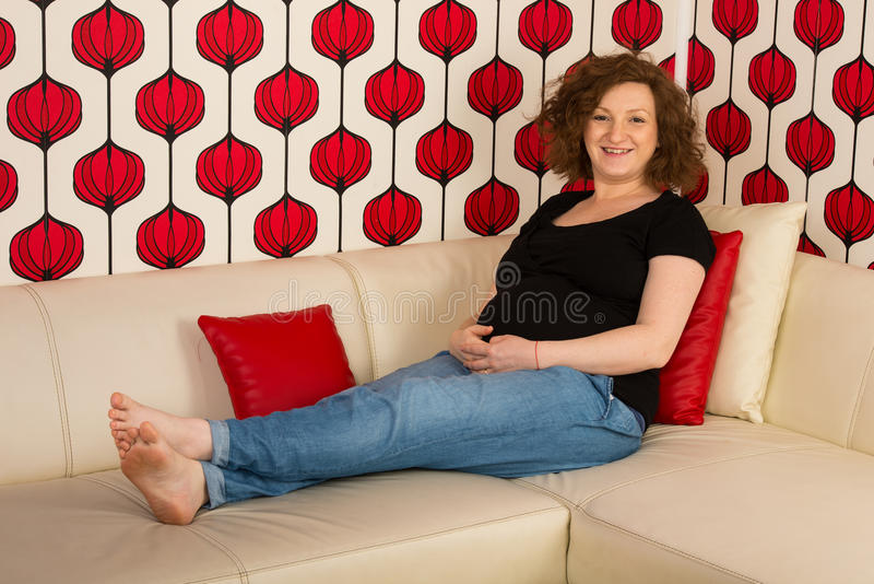Happy pregnant woman home royalty free stock photo