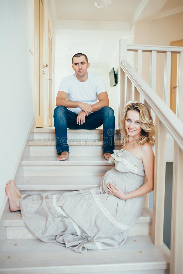 A happy pregnant woman with husband. A happy pregnant women with husband. interior stock photos