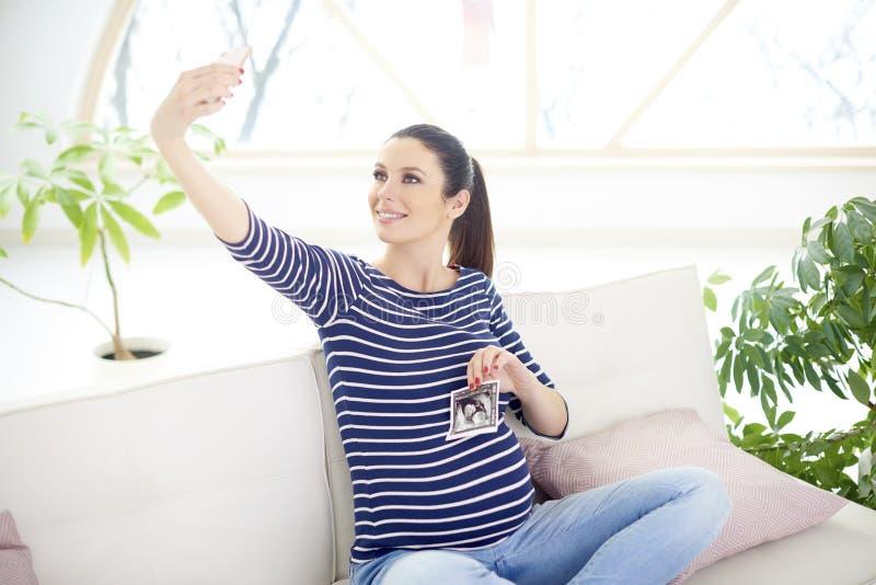 Happy pregnant woman portrait stock images