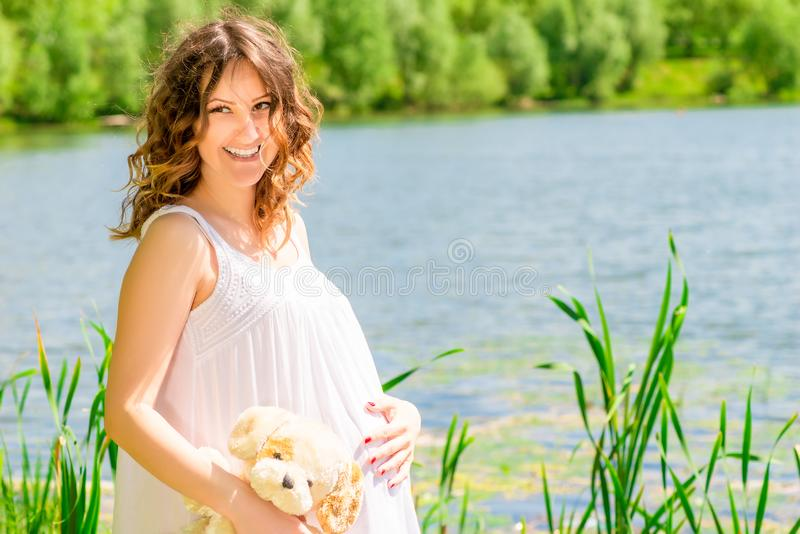 Happy pregnant woman posing on nature royalty free stock image