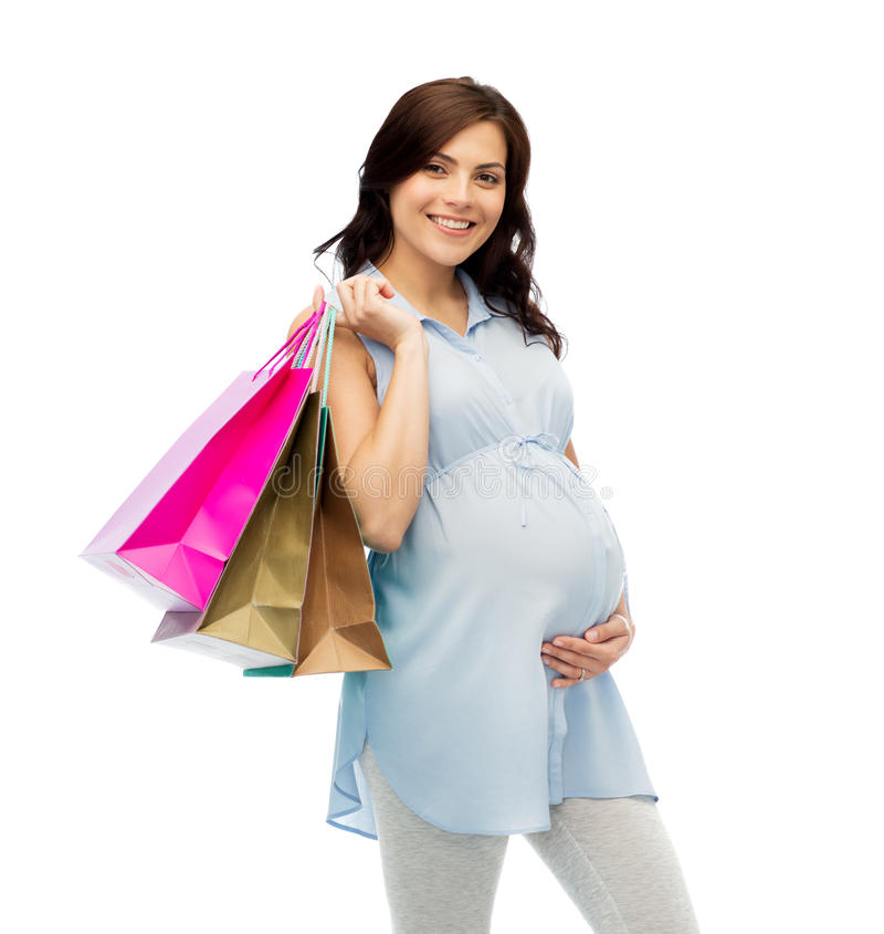 Happy pregnant woman with shopping bags stock photography