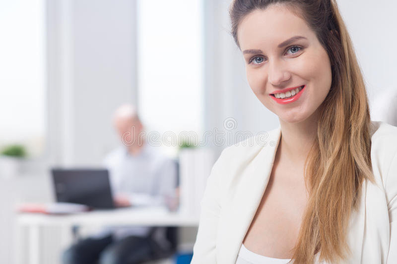 Happy pregnant woman at work royalty free stock photography