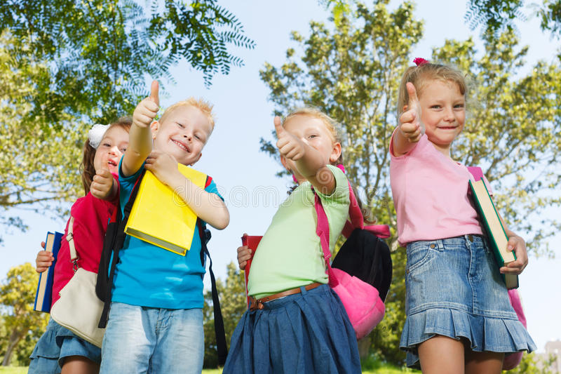 Happy preschoolers. Showing thumbs up royalty free stock image