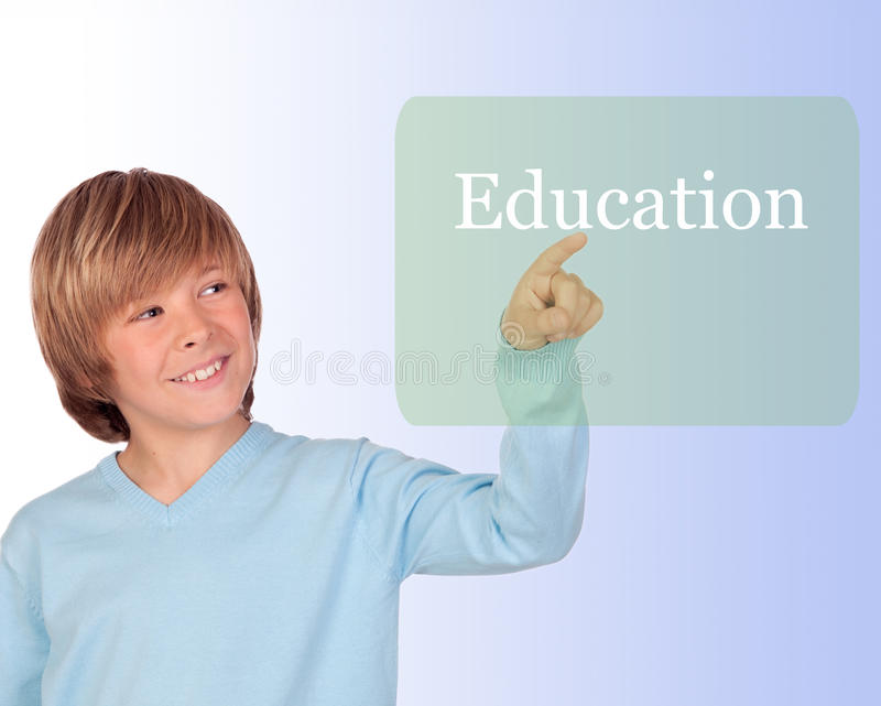 Happy preteen boy pointing the word Education stock images