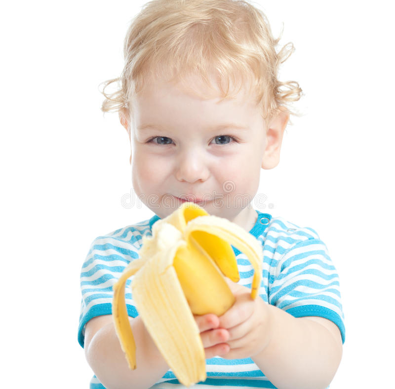Happy pretty child eating healthy food royalty free stock photography