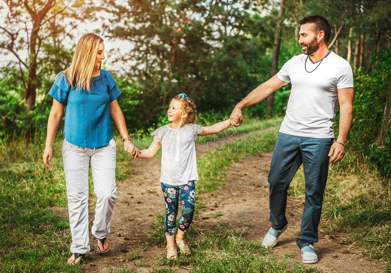 Happy pretty family have fun outdoor stock photos
