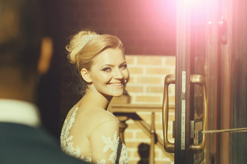 Happy pretty girl or cute bride smiling to groom royalty free stock photography