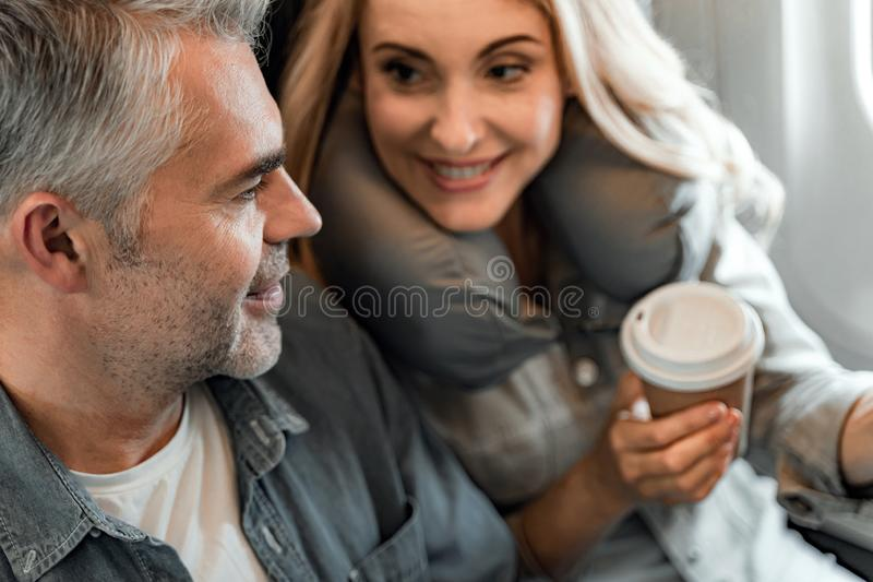 Smiling young woman is looking at man in cabin stock images