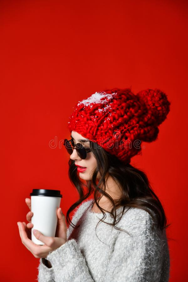 Happy pretty young woman drinking coffee-to-go and thinking in the city royalty free stock photography
