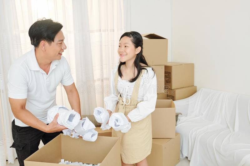 Family unpacking tableware stock photo