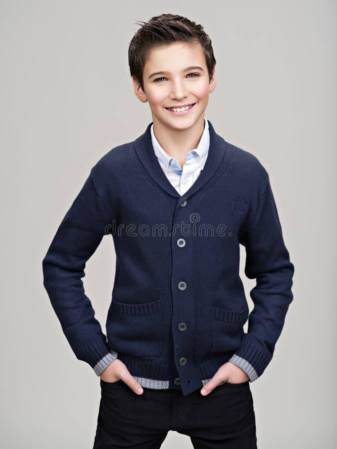 Happy pretty teenage boy posing at studio stock images