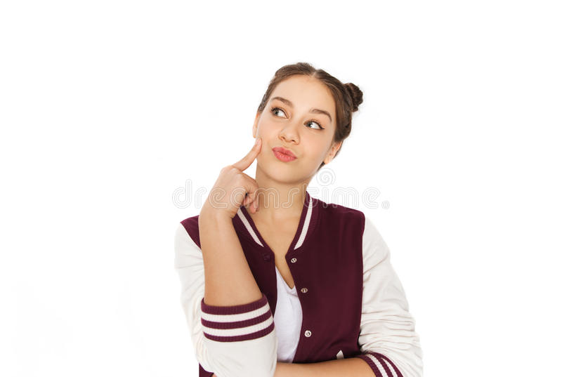 Happy pretty teenage girl thinking. People and teens concept - happy pretty teenage girl thinking royalty free stock photos