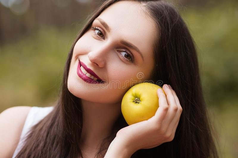 Happy pretty woman fruit picnic nature concept. royalty free stock photos