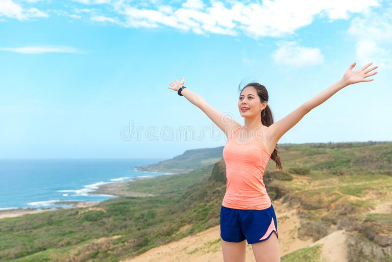 Happy pretty woman runner going to running royalty free stock image