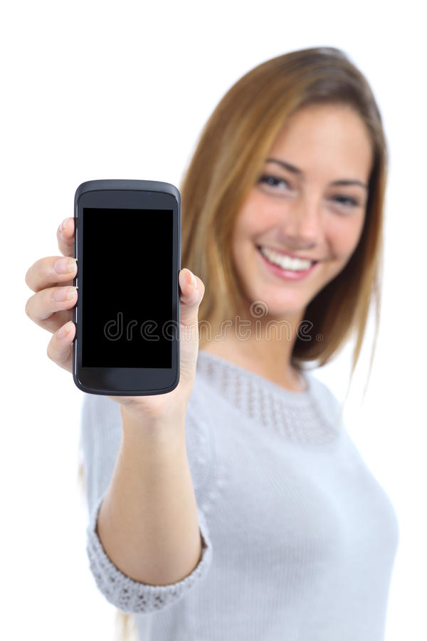 Happy pretty woman showing a blank smart phone screen. Isolated on a white background