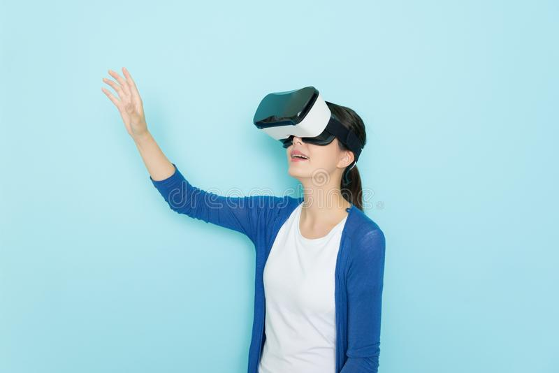 Happy pretty woman wearing VR device headset royalty free stock photo