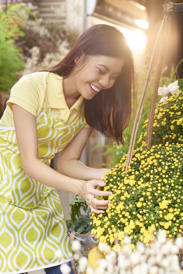 Florist enjoying her work stock photo