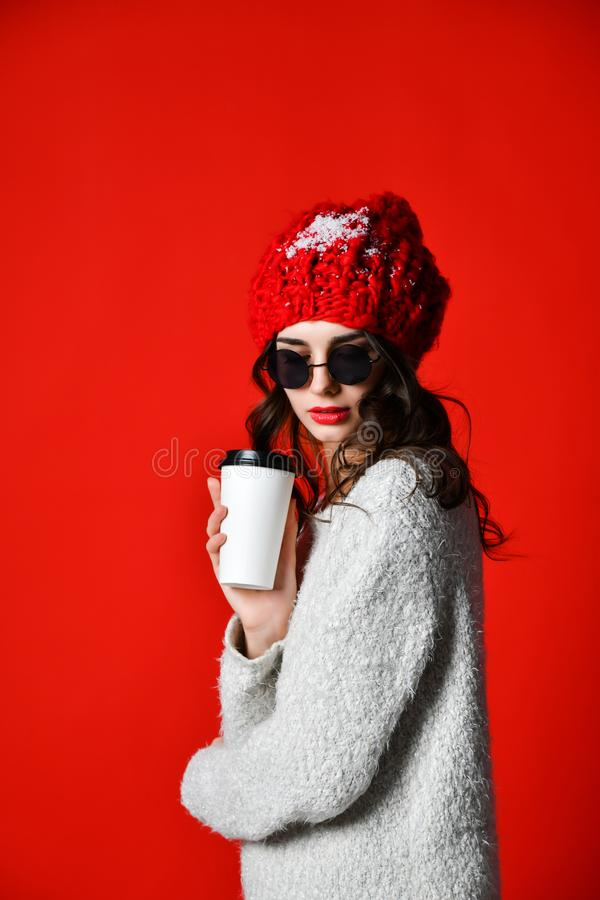 Happy pretty young woman drinking coffee-to-go and thinking in the city stock image