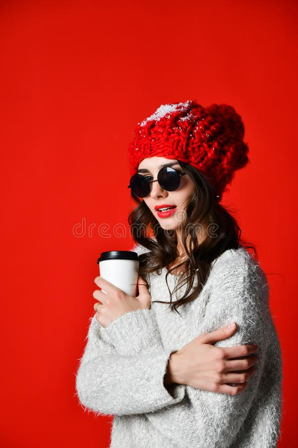 Happy pretty young woman drinking coffee-to-go and thinking in the city royalty free stock photo