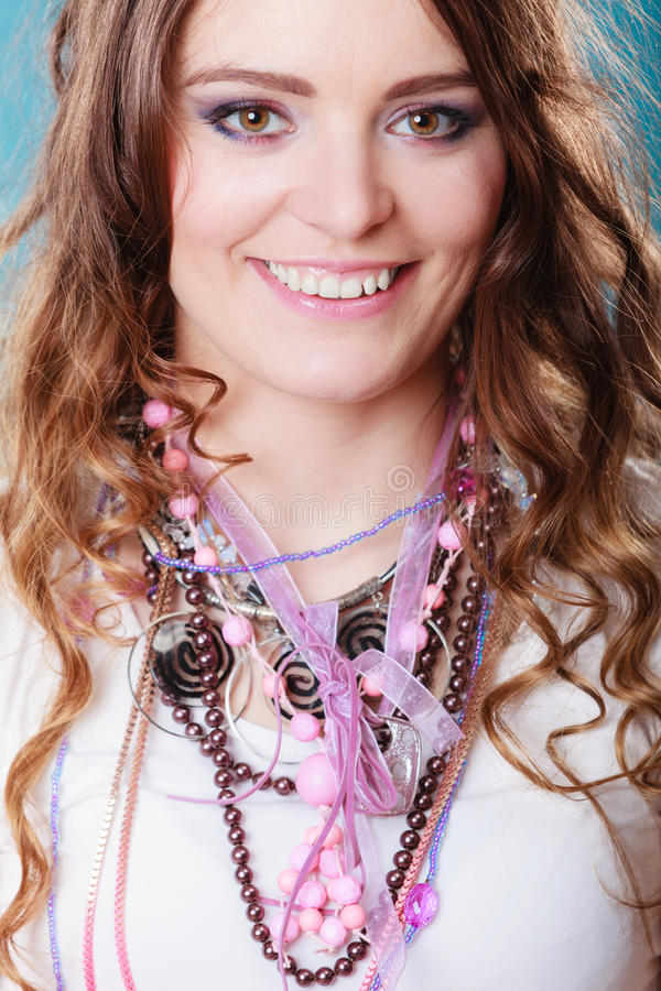 Happy pretty young woman wearing jewelry necklaces stock images