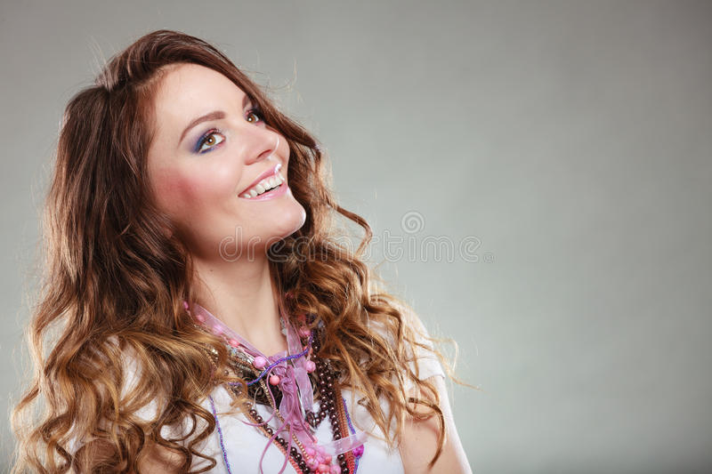 Happy pretty young woman wearing jewelry necklaces royalty free stock photos