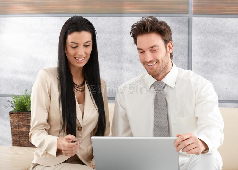 Download Happy Professionals Using Laptop Stock Photo - Image: 22194052
