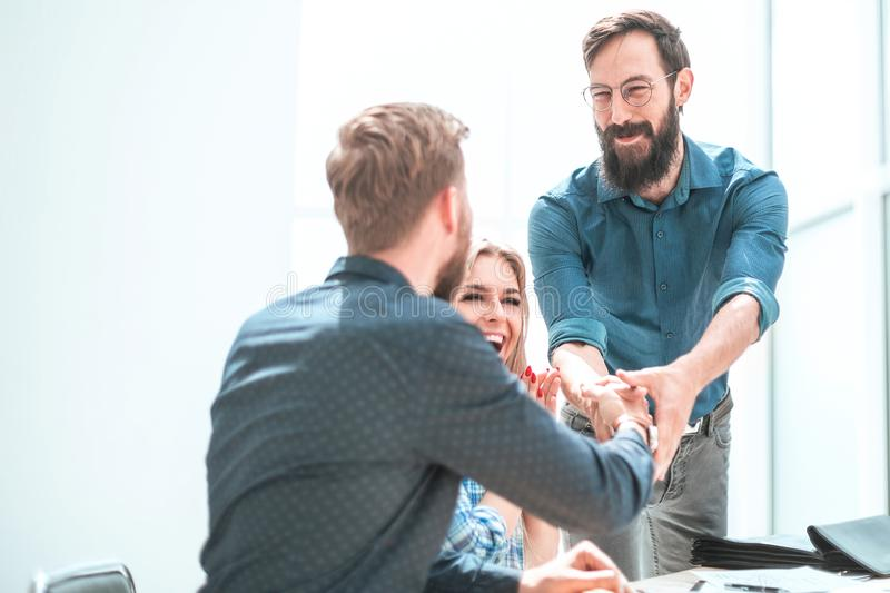 Happy project Manager shaking hands with employee. royalty free stock photo