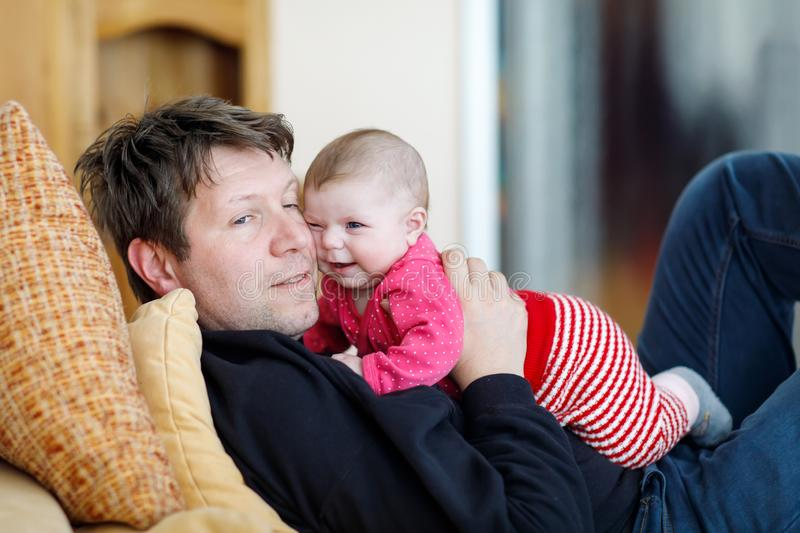 Happy proud young father with newborn baby daughter, family portrait together stock image