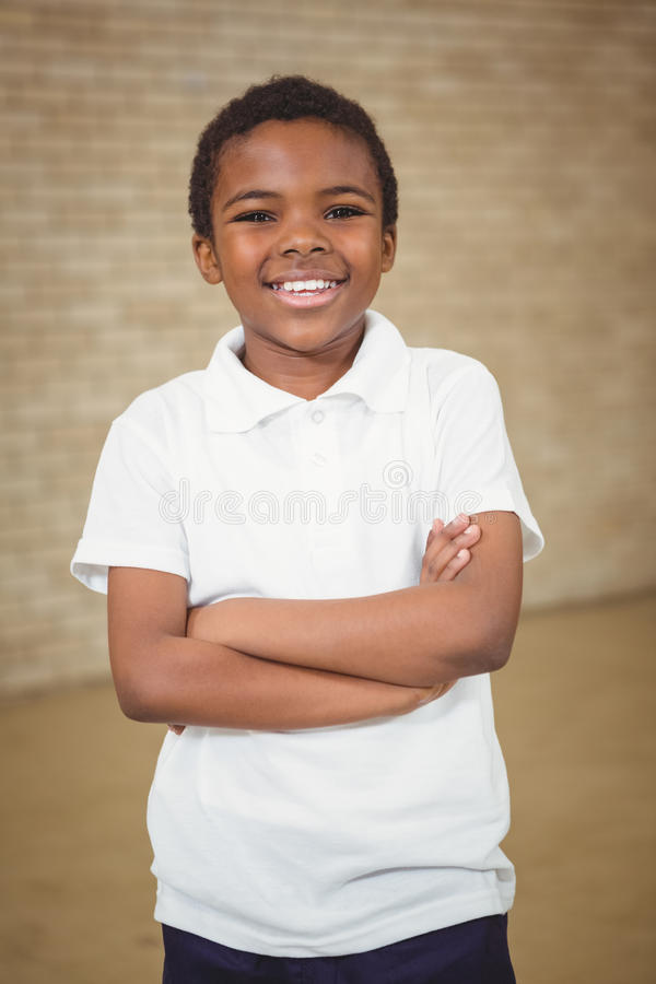 Happy pupil with folded arms. At the elementary school stock image