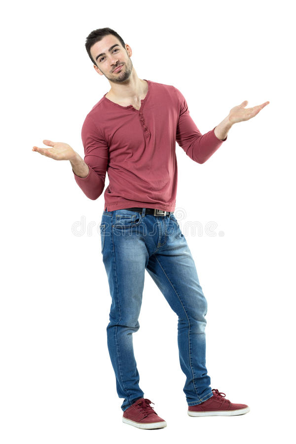 Happy puzzled stylish casual man shrugging shoulder with raised arms. Full body length portrait isolated over white background royalty free stock photography