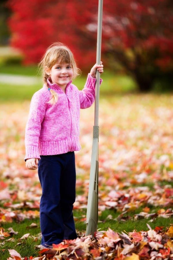 Download Happy Raking Leaves stock image. Image of pink, cute, pause - 3622425