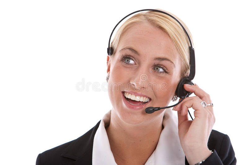 Happy receptionist. Pretty blond receptionist with radiant smile on the phone stock images